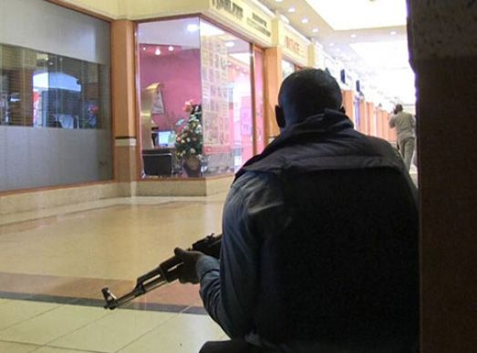 A member of the Kenyan security forces takes position inside the Westgate Mall following a Sept. 21 attack by masked gunmen in Nairobi.  Photo by Nichole Sobecki/AFP/Getty Images.