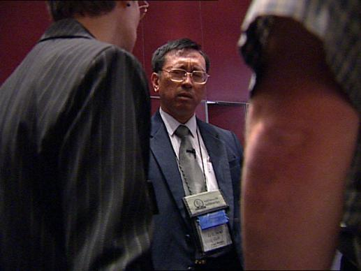 Noel Goh and the 250 other prayer delegates volunteer their time to pray with people they've never met, and may never see again. Video still by UMTV/United Methodist Communications