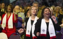M. Garlinda Burton (right) and Kathi Smith Edwards celebrate after being consecrated as deaconesses in the United Methodist Church during the United Methodist Women's Assembly at the Kentucky International Convention Center in Louisville, Ky. Photo by Mike DuBose, UMNS.