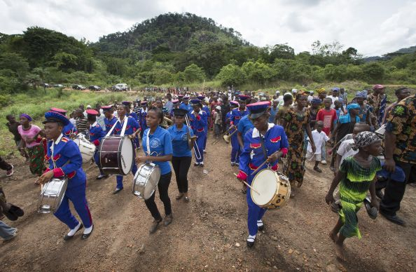 A marching band from Queen of the Rosary School in Bo, Sierra Leone, leads a parade in celebration of the dedication of Valunia United Methodist Church in Monghere, outside Bo.