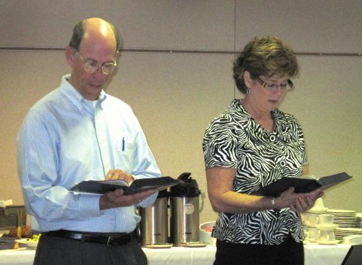 East Ohio Area Bishop John Hopkins, at left, and Tammy Gaines, vice president of Abingdon Press, take part in worship at the recent Call to Action meeting.  Photo by Heather Hahn, UMNS.
