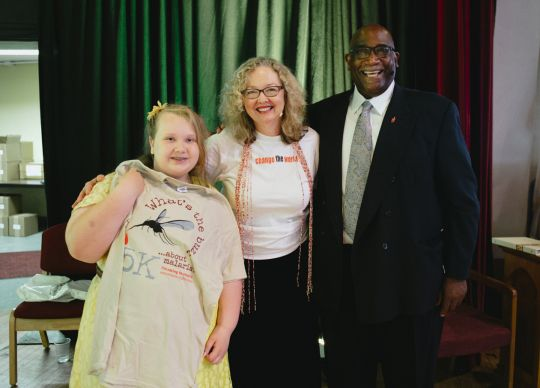 Gracie Douglas, a fourth-grader from Leipic United Methodist Church, raised $130 at school for Imagine No Malaria.  With her are Bishop Gregory V. Palmer and the Rev. Bobbi Kaye Jones, guest speaker from the Texas Annual Conference. Photo by Benjamin Derkin, West Ohio Conference.