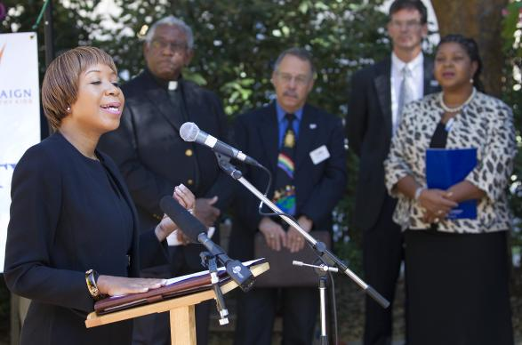 Pamela Roshell, flanked by faith leaders and other health officials, addresses a press conference on ending childhood obesity at West End United Methodist Church in Nashville, Tenn. Roshell is regional director of Region IV of the U.S. Department of Health and Human Services. Photo by Mike DuBose, UMNS