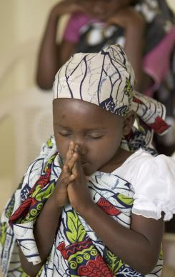 A child prays during morning worship at an orphanage operated by the East Angola Annual Conference of the United Methodist Church in Malanje, Angola.