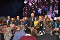Bishops pray with delegates during the last day of the Special Session of the General Conference Tuesday in St. Louis, Missouri.