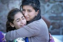 Zoya Hameed (right), a physician from the United Kingdom, hugs Hanin, a frightened Syrian refugee girl, on a beach near Molyvos, on the Greek island of Lesbos, on October 30, 2015. The girl was on a boat full of refugees that traveled to Lesbos from Turkey. The boat was provided by Turkish traffickers to whom the refugees paid huge sums to arrive in Greece. Hameed is one of hundreds of volunteers on the island who receive the refugees and provide them with warm clothing and medical care before continuing to Western Europe.