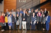 Commission on a Way Forward moderators shown gathered at a previous meeting held at the United Methodist Publishing House.
