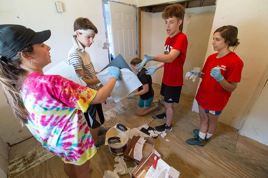 Members of a volunteer team from First United Methodist Church in Wichita Falls, Texas, install floor tiles in a Slidell, La., home damaged by Hurricane Katrina. Photo by Mike DuBose, UMNS