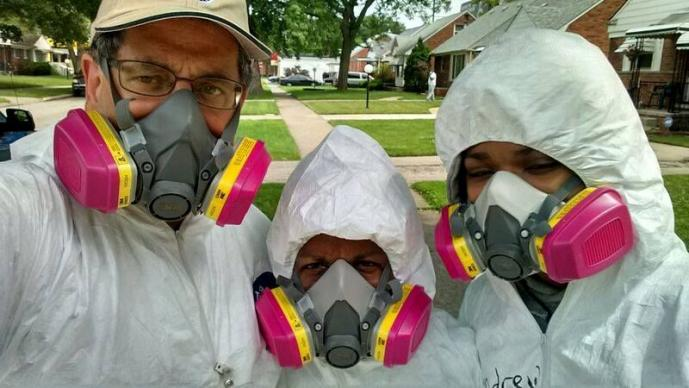 Volunteers wearing protective gear gather to help homeowners in Detroit who were hit by floods in 2014. From left are: Lawrence Matthews of the Mennonite Disaster Service; Cheryl Tipton, Disaster Case Manager with the Northwest Detroit Flood Recovery Project of The United Methodist Church; and Andrew Massey,15, of St. Paul's United Methodist Church in Detroit. Photo courtesy of the Northwest Detroit Flood Recovery Project.