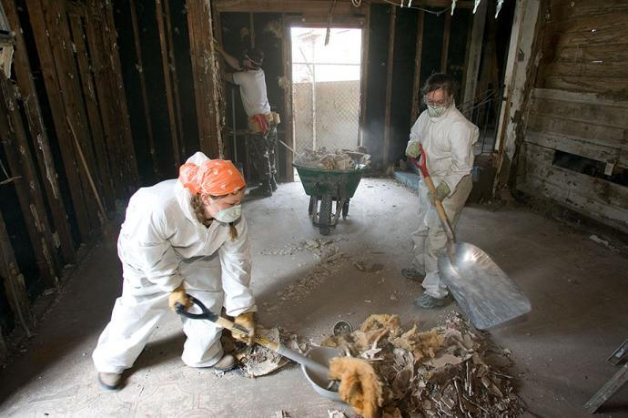 Virginia Tech students Lisa Rubin (left) and Rachel St. John help gut the interior of Ernest Franklin's home in New Orleans during their spring vacation in 2006. The group was one of several working through the Louisiana United Methodist Storm Recovery Center following Hurricane Katrina. Collaborative relationships established between faith-based, secular and governmental groups in the recovery from Hurricane Katrina have changed the face of local disaster response, relief officials said. File photo by Mike DuBose, UMNS.