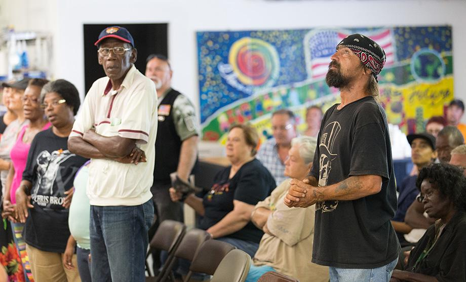 Earl Wollitt (right, foreground) casts his eyes upward during worship at Seashore Mission United Methodist Church in Biloxi, Miss. Photo by Mike DuBose, UMNS.