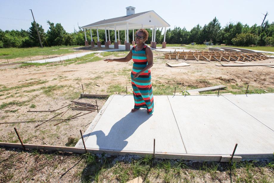 Dorothy Booker walks along the incomplete outdoor prayer pavilion at historic Gulfside Assembly in Waveland, Miss. Hurricane Katrina destroyed every building on the grounds in 2005. Photo by Mike DuBose.