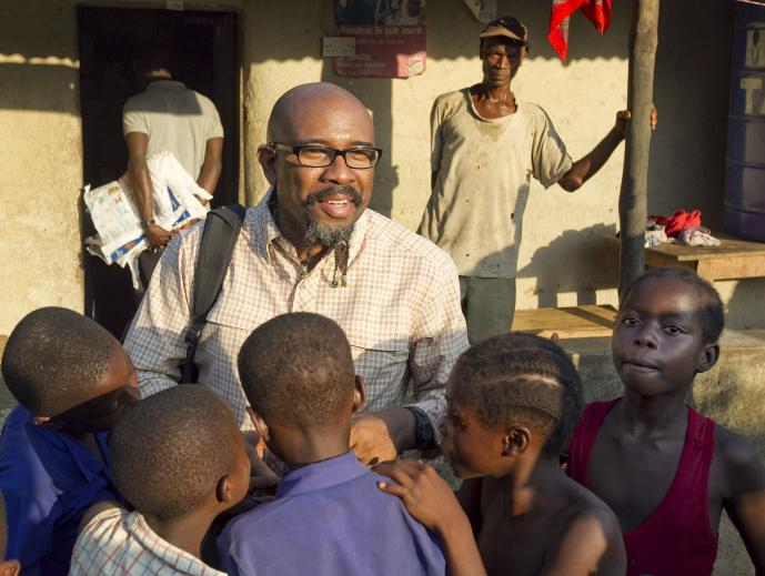 The Rev. Rudy Rasmus is a local pastor who has led his church, St. John's United Methodist in downtown Houston, to mega-church status. Rasmus, seen here during an Imagine No Malaria net distribution in Sierra Leone in 2010, is a popular author and speaker as well. File photo by Mike DuBose, UMNS.