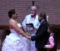 Ronald and Shena Boone celebrate Valentine's Day with a free wedding at Trinity United Methodist Church. Photo by Liz Johnson & Jay Foot.
