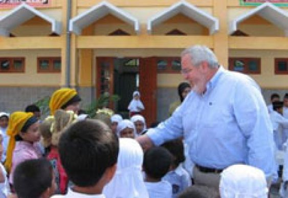 The Rev. Sam Dixon greets children in Indonesia in this file photo.