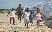 Children play between rows of tents at Camp Corail where the United Methodist Committee on Relief is helping provide services. UMNS photo by Mike DuBose.