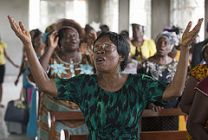 Parishioners sing during worship at Charles Davies Memorial United Methodist Church in Freetown, Sierra Leone on the Sunday prior to a distribution of insecticide-treated mosquito nets by the denomination's Imagine No Malaria campaign in the Bo District. Photo by Mike DuBose, UMNS.