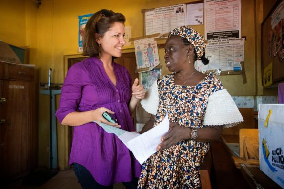 Maeghan Orton (left) learns about how medical records are kept at the United Methodist Church's Mercy Hospital in Bo Sierra Leone, from Taiwo Sesay, who oversees the hospital's maternity unit.