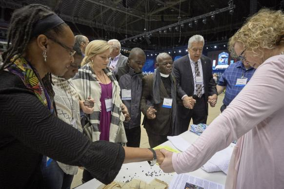 Delegates pray together during the February 23, 2019, opening session of the Special Session of the General Conference of The United Methodist Church. Photo by Paul Jeffrey for United Methodist News Service.