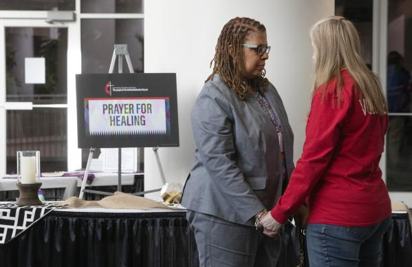 Scene from the prayer room of the 2019 General Conference in St. Louis. Praying together are Yvette Richards from the Missouri Conference and Jennifer Long, volunteer. Photo by Kathleen Barry, UMNS.