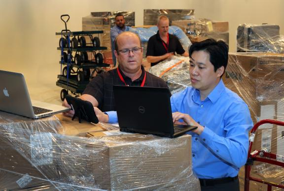 Members of the technology team prepare to send equipment to Portland for the 2016 General Conference. Photo by Kathleen Barry, United Methodist Communications.