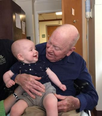 When he was a pastor in the Atlanta area, retired United Methodist Bishop Bevel Jones III would invite preachers from The Protestant Hour to speak at his churches. He's seen here with great-grandson Eli Jones. Photo courtesy the Rev. David Bevel Jones