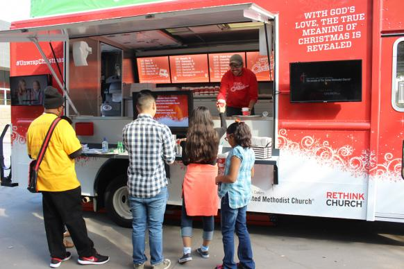 Visitors in the Dallas Arts District enjoyed free cocoa from the True Meaning of Christmas tour staff and volunteers from St Paul's, Christ's Foundry, and Dallas First United Methodist churches. Dallas was the first stop on the tour on Dec. 3, 2017.
