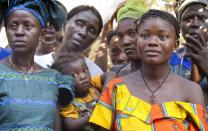 Residents of the Gbo Chiefdom outside Bo, Sierra Leone listen during a welcome event for a mosquito net distribution by the Imagine No Malaria campaign. Photo by Mike DuBose, UMNS.