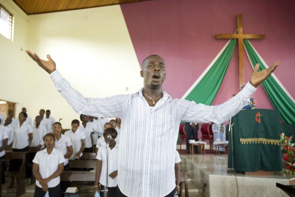 Nestor Akoblo leads the choir during Sunday worship at the Temple Emmanuel United Methodist Church in Abidjan, Côte d'Ivoire. Photo by Mike DuBose, UMNS.