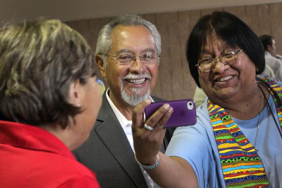 Mobile phones make it easy to tweet and share comments and photos. Pictured: Bishop Elias Galvin from Scottsdale, Arizona, and Tweedy Sombrero from Trinity United Methodist Church in Yuma, Arizona, view a photograph taken by Anne Marshall from the Connectional Table using a cell phone. Photo by Kathleen Barry, United Methodist Communications.