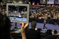The Rev. Janet Gollery McKeithen of Santa Monica, California, uses her iPad to catch the action on the floor at the 2012 General Conference of The United Methodist Church in Tampa, Florida. Photo by Kathleen Barry, United Methodist Communications.