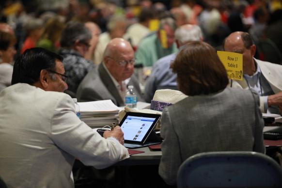 The Rev. Eradio Valverde, Jr. from the Southwest Texas Annual (regional) Conference multi-tasks while listening to the May 4 plenary session at the 2012 United Methodist General Conference in Tampa, Fla. Photo by Kathleen Barry, UMNS.