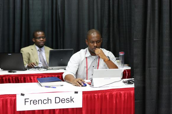 Isaac Broune and Joe Tueche Ndzulo handle the French desk during the 2016 United Methodist General Conference in Portland, Oregon. Photo by Kathleen Barry, United Methodist Communications.