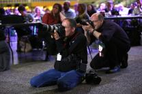 Mike DuBose from United Methodist Communications and David Stucke of the Dakotas Annual Conference capture moments digitally during the 2016 United Methodist General Conference in Portland, Oregon. Photo by Kathleen Barry, United Methodist Communications.