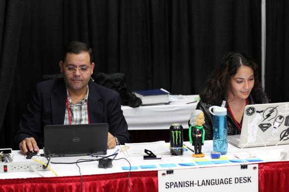 Gustavo Vasquez and Michelle Maldonado work at the Spanish-language desk during the 2016 United Methodist General Conference in Portland, Oregon. Photo by Kathleen Barry, United Methodist Communications.