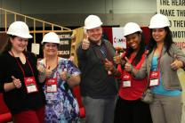 (From left) Laura Buchanan, Myca Alford, Jon Watson, Royya James and Poonam Patodia stand inside the exhibit booth for United Methodist Communications at the 2016 United Methodist General Conference in Portland, Oregon. Photo by Kathleen Barry, United Methodist Communications. Cropped from original.