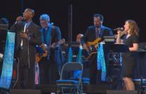 Video image shows file photo of worship service from General Conference, courtesy of United Methodist Communications.
