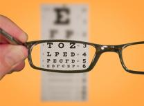 Eyechart with glasses. Photo copyright Ken Teegardin, Flickr.com. Creative Commons license.