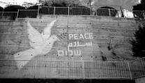 A mural promoting peace in three languages, English, Arabic and Hebrew, adorns a wall outside the Mar Elias Educational Institute in Ibillin, Israel. 1999 file photo by Mike DuBose, UMNS