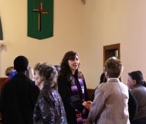 Rev. Sherry Cothran Woosley greets people after the service at West Nashville United Methodist Church. A UMNS photo by Kathleen Barry.