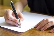 Person writing. Image copyright slav / iStockPhoto.com.