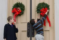 Children hang wreaths on the sanctuary door at Belmont United Methodist Church in Nashville, Tenn., during the church's annual Hanging of the Greens service. Photo by Mike DuBose, United Methodist Communications.