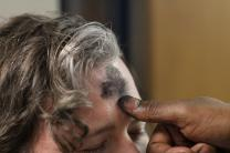Man receives ashes on his forehead.  Photo illustration by Kathleen Barry, United Methodist Communications.