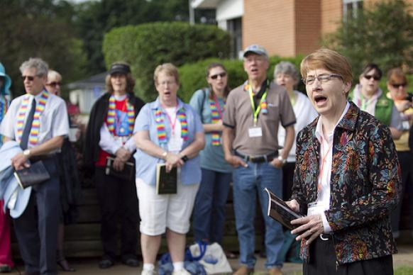 Sue Laurie (right) leads supporters of the Rev. Amy DeLong in singing hymns outside Peace United Methodist Church in Kaukauna, Wis., prior to the second day of DeLong's United Methodist Church trial on charges she violated the denomination's rules on sexuality. A UMNS photo by Mike DuBose.