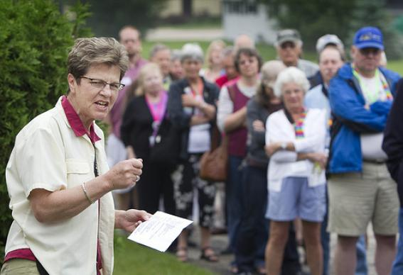 The Rev. Janet Ellinger leads worship outside Peace United Methodist Church in Kaukauna, Wis., where the Rev. Amy DeLong is being tried on charges she violated United Methodist Church law on sexuality. Ellinger is pastor of River Falls (Wis.) United Methodist Church. A UMNS photo by Mike DuBose.