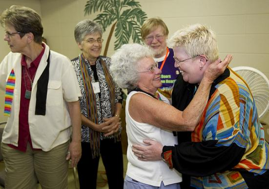 The Rev. Amy DeLong (right) is greeted by supporters at the conclusion of her United Methodist Church trial at Peace United Methodist Church in Kaukauna, Wis. A UMNS photo by Mike DuBose.