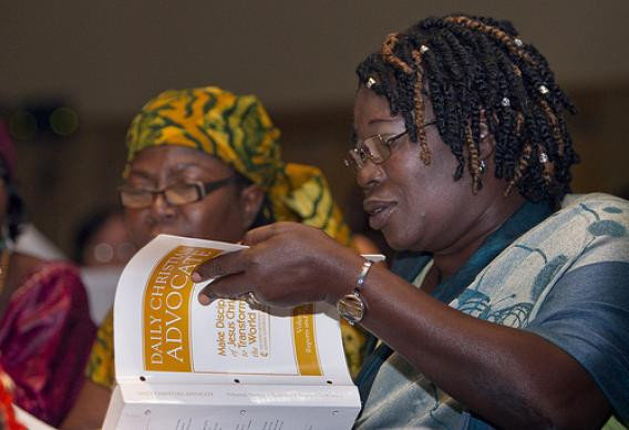 Delegate Kathleen Charles (right) of Sierra Leone looks through a copy of the Daily Christian Advocate during a briefing for Central Conference delegates to the 2012 United Methodist General Conference in Tampa, Fla. At left is delegate Mariatu Finoh of Sierra Leone. A UMNS photo by Mike DuBose.