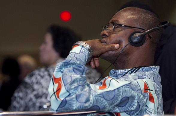Delegate Antony Beugre of Côte d'Ivoire listens to French translation of a briefing for international delegates to the 2012 United Methodist General Conference in Tampa, Fla. A UMNS photo by Mike DuBose.