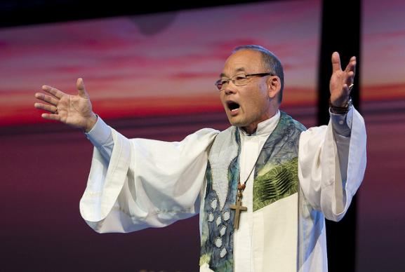 Bishop Robert Hoshibata preaching at the Thursday evening worship service