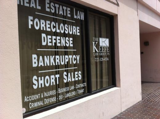 A law firm's window in downtown St. Petersburg, Fl